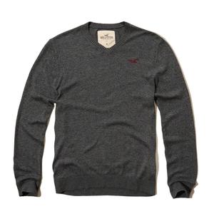 Strukturierter Pullover mit V-Ausschnitt und Symbol