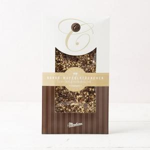 Vollmichschokolade bestreut mit Kakao-Waffelstückchen 100g 3,99 € / 100g