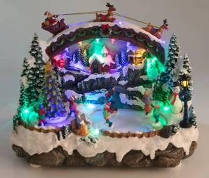Weihnachtsstadt mit Licht Musik und Eisläufern Wetekom