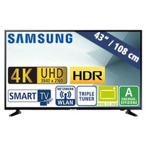 "43""-Ultra-HD-LED-TV UE43NU7099 • HbbTV • 2 HDMI-Eingänge, USB-/CI+-Anschluss, 20 Watt RMS • Stand-by: 0,5 Watt, Betrieb: 70 Watt • Maße: H 56,3 x B 97,0 x T 5,9 cm • Energie-Effizienz A"