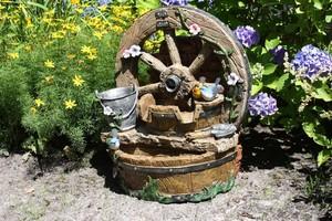 Harms Brunnen POSEIDON in Holzoptik mit Deko-Rad