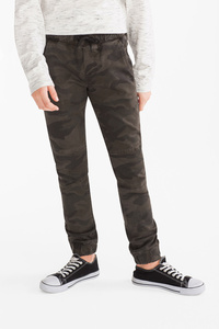 Here and There         THE TAPERED JEANS
