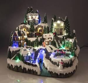 Weihnachtliche Dorfszene mit Bleuchtung und Musik