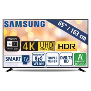 "65""-Ultra-HD-LED-TV UE65RU7099 • HbbTV • 3 HDMI-/2 USB-Anschlüsse, CI+ • 20 Watt RMS • Stand-by: 0,5 Watt, Betrieb: 118 Watt • Maße: H 83,7 x B 145,8 x T 5,9 cm • Energie-Effizienz A+ ("