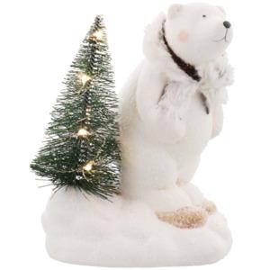 Figur mit beleuchtetem Weihnachtsbaum